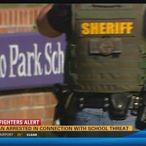Woman arrested in connection with school threat