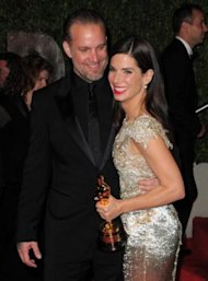 Actress Sandra Bullock and her husband Jesse James arrive at the 2010 Vanity Fair Oscar Party Hosted after the Oscars on March 7, 2010. Bullock won an award for best actress that night; James confessed he was cheating on her soon after. (Photo: Jordan Strauss/WireImage)