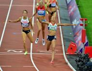 Britain's Jessica Ennis (front) celebrates as she crosses the finish line of the women's heptathlon 800m at the athletics event of the London 2012 Olympic Games