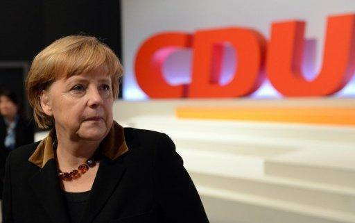 Angela Merkel attends the CDU conference in Hanover. Merkel was overwhelmingly re-elected her party's leader Tuesday as she kicked off her bid for a third term, saying only she could steer Germany through turbulence at home and abroad.