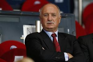 Brazil's coach Scolari attends the Champions League quarter-final first leg soccer match between Chelsea and Paris St Germain at the Parc des Princes Stadium in Paris