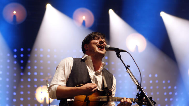 FILE - In this Feb. 6, 2013 file photo, lead singer Marcus Mumford performs with Mumford & Sons during a concert at the Barclays Center in New York. Mumford and Sons will be one of the headliners at the Lollapalooza music festival in Chicago's Grant Park in August 2013. (Photo by Jason DeCrow/Invision/AP)