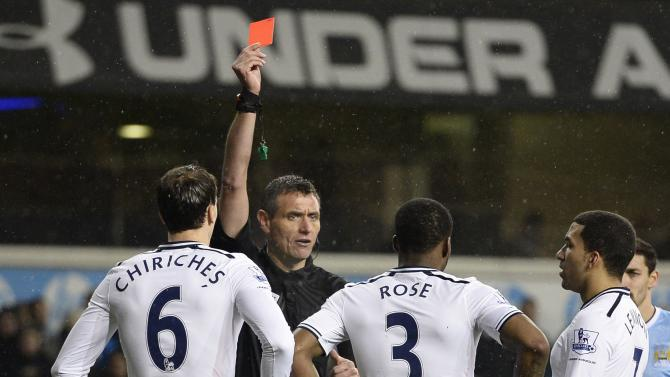 Tottenham Hotspur's Rose is shown a red card by referee Marriner during their English Premier League soccer match against Manchester City at White Hart Lane in London