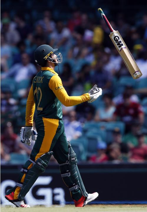South Africa's de Kock throws his bat as he walks off the field after being dismissed by West Indies bowler Holder for twelve runs during the Cricket World Cup match at the SCG