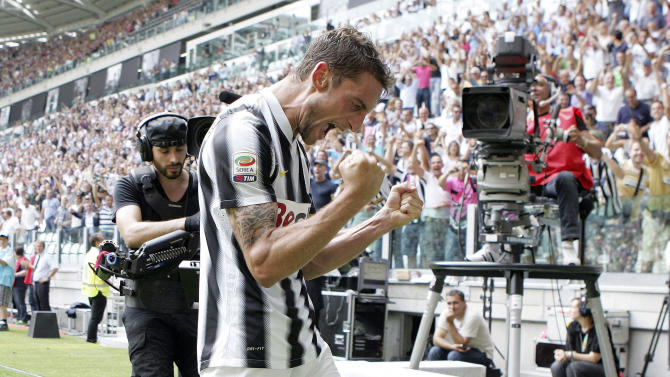 Juventus' Claudio Marchisio celebrates after scoring during a Serie A soccer match between Juventus and Parma at the Juventus Stadium in Turin, Italy, Sunday, Sept. 11, 2011. Juventus opened Serie A with a sparkling 4-1 win over Parma on Sunday in the first official match in its new stadium. (AP Photo/Jonathan Moscrop, Lapresse)   ITALY OUT