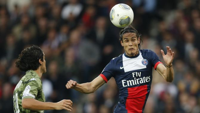 Paris St Germain's Edinson Cavani challenges Bastia's Francois Modesto during their French Ligue 1 soccer match at the Parc des Princes Stadium in Paris