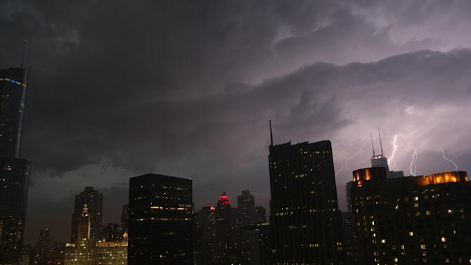 Lightning erupts over downtown Chicago on Wednesday, June 12, 2013, as a line of powerful storms cross over the Midwest. A massive line of storms packing hail, lightning and tree-toppling winds began rolling through the Midwest Wednesday evening and could affect more than one in five Americans from Iowa to Maryland before subsiding. (AP Photo/Dr. Scott M. Lieberman)