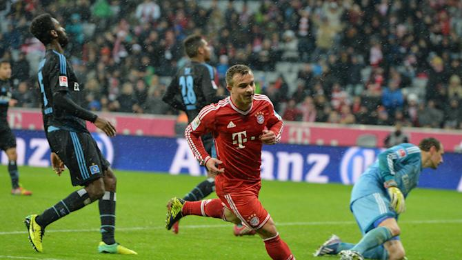 Bayern's Xherdan Shaqiri, center,  of Switzerland smiles after scoring during  the German first division Bundesliga soccer match between FC Bayern Munich and Hamburger SV  in Munich, Germany, Saturday, Dec. 14, 2013