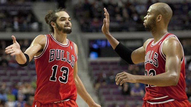 Chicago Bulls center Joakim Noah (13) and power forward Taj Gibson (22) (Reuters)