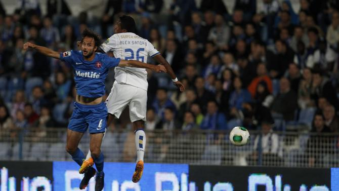 Belenenses' Meira heads for the ball with Porto's Sandro during their Portuguese Premier League soccer match in Lisbon