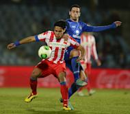 Atletico Madrid's Radamel Falcao (L) fights for the ball with Getafe's Alvaro Vazquez during their Spanish Copa del Rey match at the Coliseum Alfonso Perez stadium in Getafe, on January 10, 2013. Atletico return to La Liga competition on Sunday when they host Zaragoza