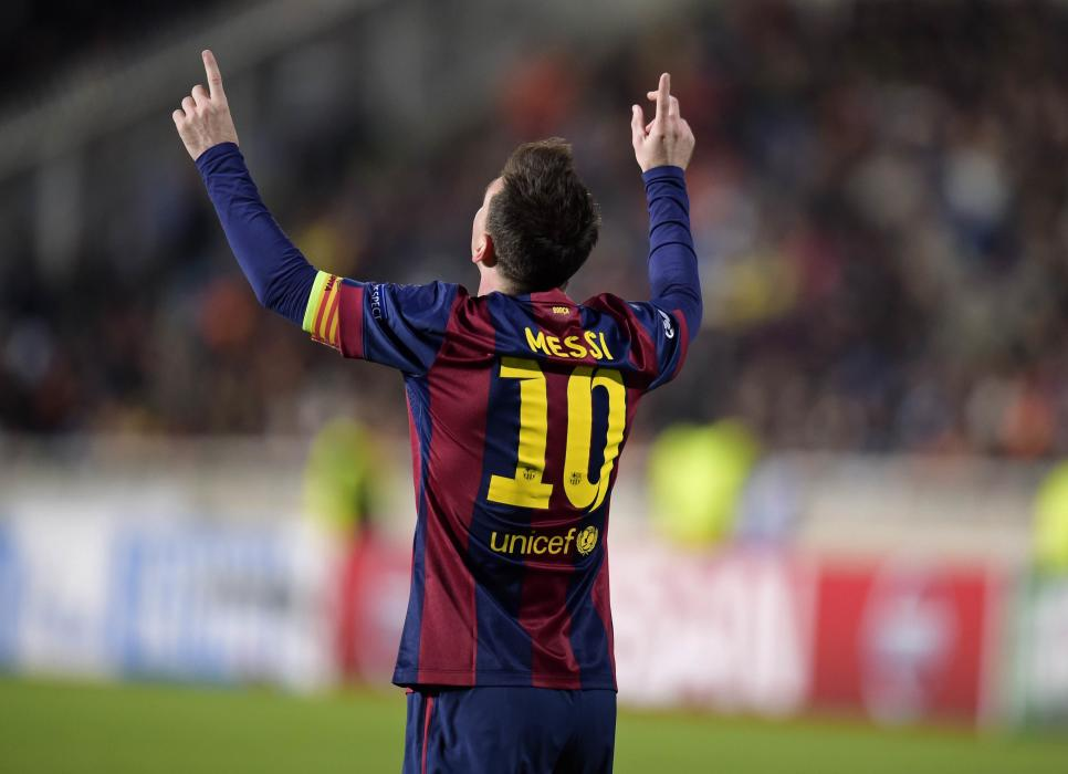 Barcelona's Messi celebrates after scoring a goal against APOEL Nicosia during their Champions League Group F soccer match in Nicosia