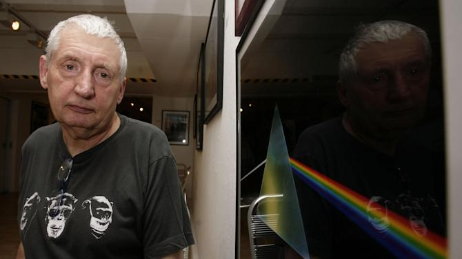"FILE - This July 24, 2008 file photo shows English graphic designer Storm Thorgerson standing next to his album cover artwork for Pink Floyd's ""The Dark Side of the Moon"" during the opening of his exhibition 'Mind Over Matter: The Images of Pink Floyd' in London. Storm Thorgerson whose eye-catching Pink Floyd and Led Zeppelin album covers captured the spirit of 1970s psychedelia, has died. He was 69. In a statement, Thorgerson's family said that he died Thursday April 18, 2013 and that ""his ending was peaceful and he was surrounded by family and friends."" (AP Photo/PA, Yui Mok, File) UNITED KINGDOM OUT  NO SALES  NO ARCHIVE"