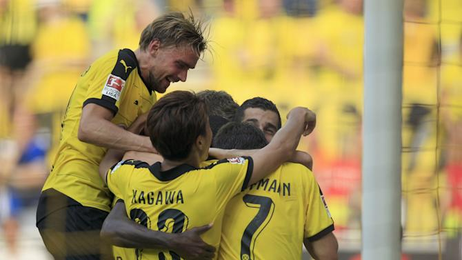 Borussia Dortmund's Schmelzer celebrates with his teammates after they scored against Hertha Berlin after their Bundesliga first division soccer match in Dortmund