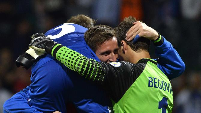 Bosnia's goalkeeper Asmir Begovic celebrates with teammates after their 2014 World Cup qualifying soccer match against Slovakia in Zilina