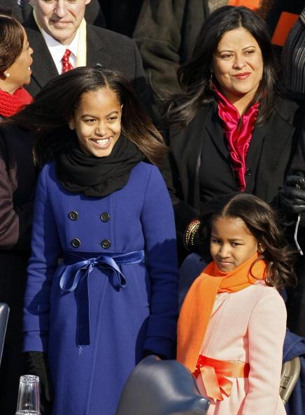Malia and Sasha Obamam stand on the stage ahead of the inauguration of Barack Obama as the 44th President of the United States of America on the West Front of the Capitol January 20, 2009 in Washingto