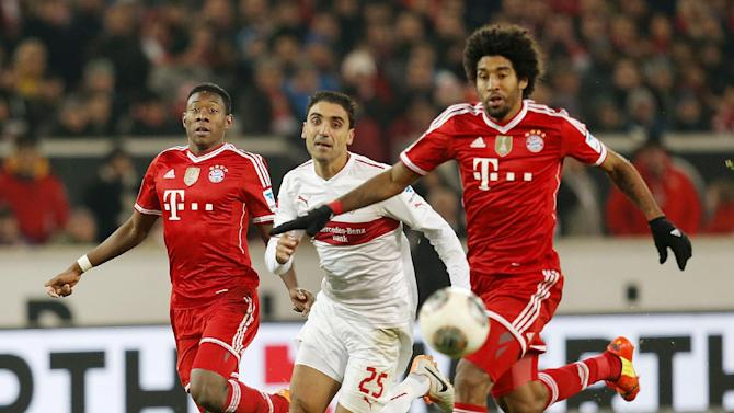 Stuttgart's Mohammed Abdellaoue of Norway, center, and Bayern's Dante of Brazil, right, and Bayern's David Alaba of Austria challenge for the ball during a German first soccer division Bundesliga match between VfB Stuttgart and FC Bayern Munich in Stuttgart, Germany, Wednesday, Jan. 29, 2014