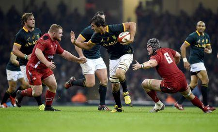 South Africa's Eben Etzebeth with Wales' Samson Lee and Dan Lydiate during their Autumn International rugby union match in Cardiff, Wales