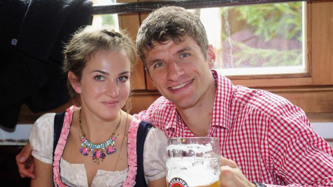Bayern Munich's Thomas Mueller and wife Lisa Mueller pose at the Oktoberfest in Munich
