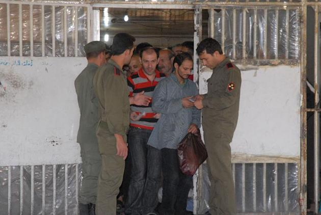 Some of the 274 inmates being readied for release from Damascus Central Prison on June 11, 2014 following a general amnesty announced by President Bashar al-Assad
