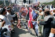 """Afghan demonstrators burn US flags and photos of actors and actresses who took part in the film """"Innocence of Muslims"""" during a protest in Kabul. The US government compiled a YouTube film of ordinary Americans condemning """"Innocence of Muslims."""""""