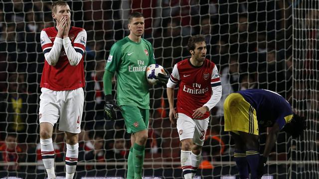 Premier League - Flamini own goal puts end to Arsenal title charge