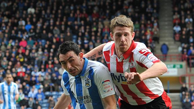 Scot Bennett, right, was taken to hospital after being stretchered off against Bristol Rovers