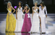 Miss Rhode Island Olivia Culpo, center, searches for an earring while standing with the other four finalists, from left, Miss Ohio, Miss Maryland, Miss Nevada and Miss Georgia during the 2012 Miss USA pageant, Sunday, June 3, 2012, in Las Vegas. (AP Photo/Julie Jacobson)