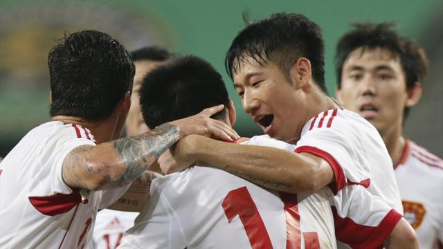 Asian Football - China hitback to hold Japan 3-3 in East Asian Cup