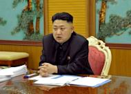 "This image released by North Korea's official Korean Central News Agency (KCNA) on January 27, 2013 shows North Korean leader Kim Jong-Un attending a security meeting at an undisclosed location in North Korea. YouTube said that a North Korean propaganda video showing New York City under attack had been removed from the site over a copyright complaint by the makers of the ""Call of Duty"" video game"