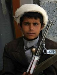 A Yemeni 11-year-old boy holds a firearm as he attends a tribal gathering in Sanaa, aimed at resolving local feuds in Arhab district. The Yemeni army has seized the Al-Qaeda strongholds of Jaar and Zinjibar, more than a year after the jihadists captured most of Abyan province