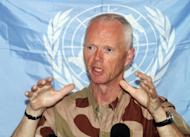 UN observer mission chief in Syria, Major General Robert Mood, addresses a news conference in the capital Damascus. UN observers suspended their mission to Syria, blaming intensifying violence as troops rained shells down on rebel bastions including Homs, where the opposition warned a massacre was imminent