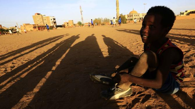 A South Sudan boy living in a Hai Al Brakaa North Sudan IDPs camp rests after playing soccer in Hajj Yusuf in Khartoum