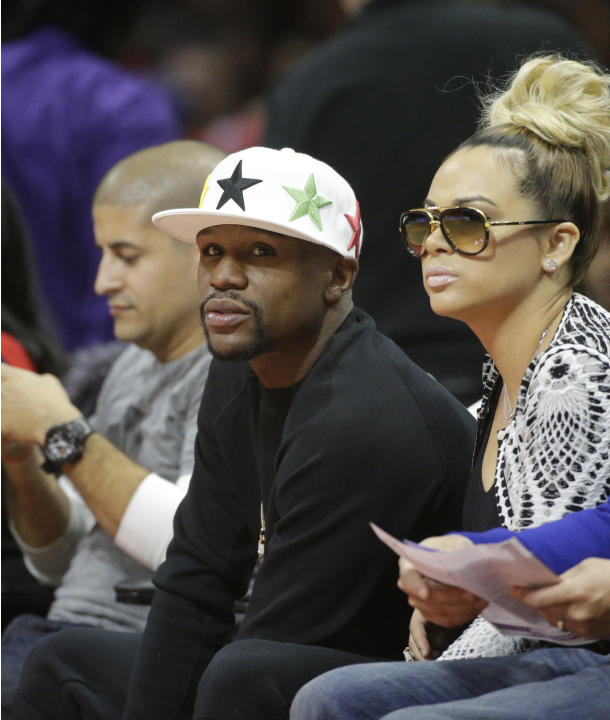 Boxer Floyd Mayweather Jr. attends an NBA basketball game between the Los Angeles Clippers and the Memphis Grizzlies, Monday, Feb. 23, 2015, in Los Angeles. (AP Photo/Jae C. Hong)