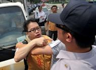 Anti-China activists and police quarrel near the Grand Hotel in Taipei. China and Taiwan signed a landmark investment pact on Thursday as hundreds of protesters voiced their anger over the island's ever closer economic ties with its giant former foe