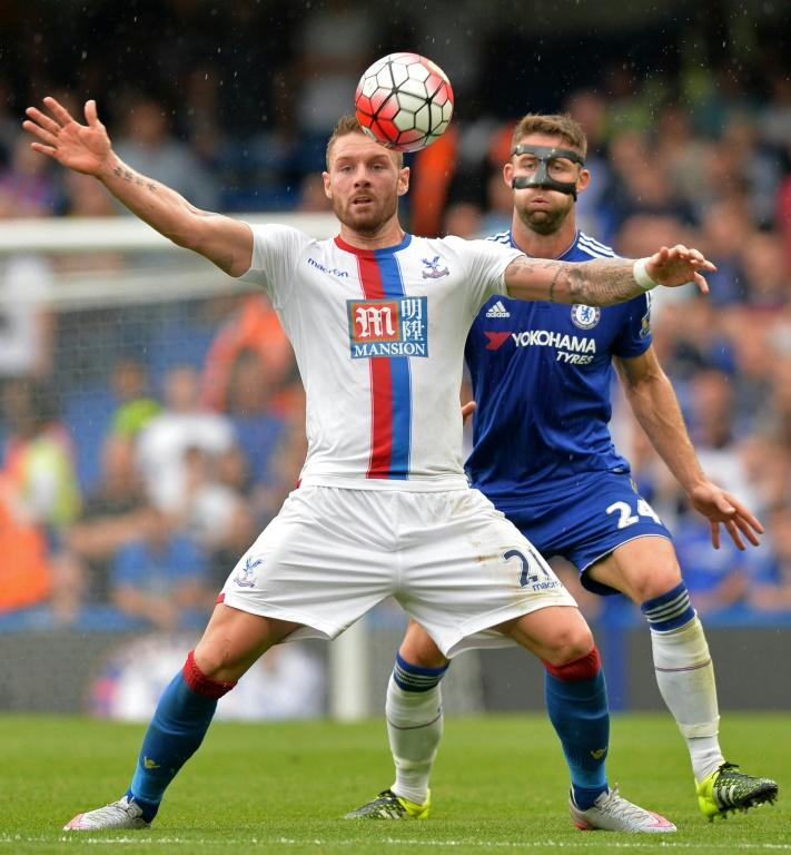 Chelsea's English defender Gary Cahill (R) vies with Crystal Palace's English striker Connor Wickham during the English Premier League football match at Stamford Bridge in London on August 29,