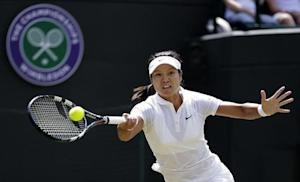Li of China hits a return to Strycova of the Czech Republic during their women's singles tennis match at the Wimbledon Tennis Championships, in London