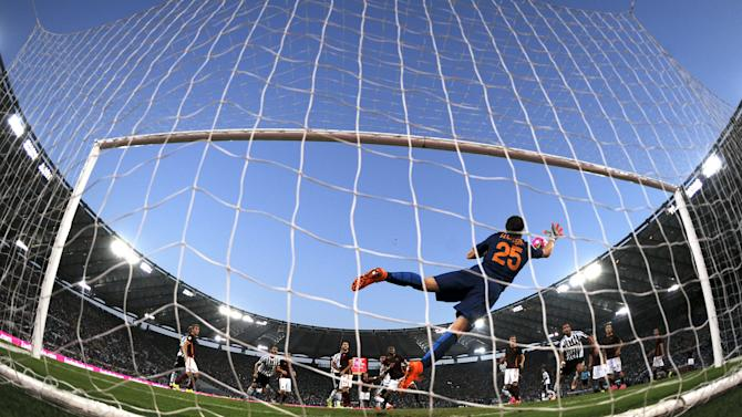 AS Roma's goalkeeper  Szczesny makes a save the match against Juventus in their Serie A soccer match at Olympic stadium in Rome