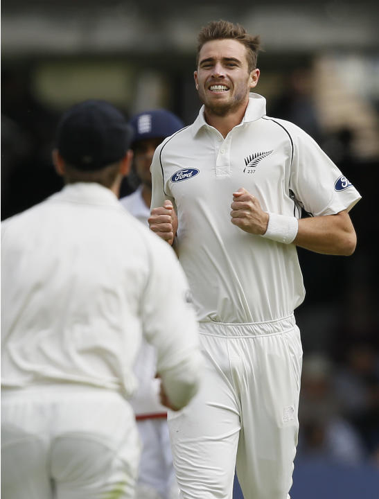 New Zealand's Tim Southee celebrates taking the wicket of England's Ian Bell during the fourth day of the first Test match between England and New Zealand at Lord's cricket ground in Londo