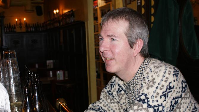 "In this photo taken Thursday, Dec. 6, 2012, American author James Thompson drinks coffee in Helsinki's 'Hilarious Pike' bar, a location central to the action in his Inspector Kari Vaari series of novels. Thompson's style is on the dark end of the ""Nordic Noir"" spectrum. The genre _ with its stark and often violent police procedurals _ has proved wildly successful for publishers and filmmakers alike. (AP Photo/David Mac Dougall)"