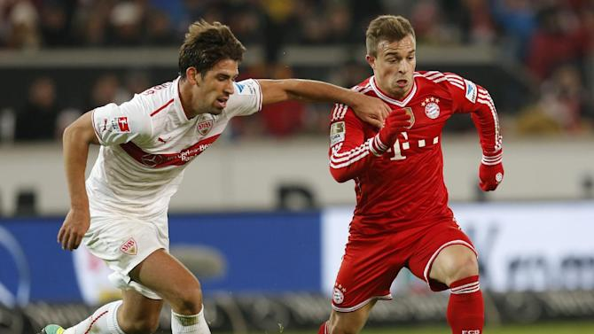 Stuttgart's Rani Khedira, left, and Bayern's Xherdan Shaqiri of Switzerland challenge for the ball during a German first soccer division Bundesliga match between VfB Stuttgart and FC Bayern Munich in Stuttgart, Germany, Wednesday, Jan. 29, 2014