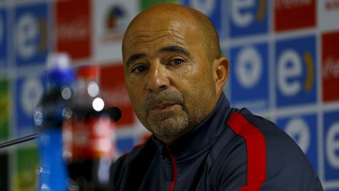 Chile's head coach Jorge Sampaoli listens a question during a news conference before their 2018 World Cup qualifying match against Brazil on Thursday, in Santiago