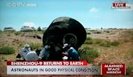 This photograph of a China CCTV broadcast shows the Shenzhou 9 space capsule lying on its side after landing in an autonomous region of China in Inner Mongolia on June 29, 2012 Beijing time (10 p.m. June 28 EDT) to end a 13-day mission to the T