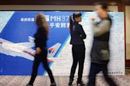 A billboard is displayed at the Metro Park Hotel as Chinese relatives of passengers on missing flight MH370 have a meeting on April 23, 2014