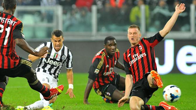 Juventus forward Sebastian Giovinco, second from left, scores during a Serie A soccer match between Juventus and AC Milan at the Juventus stadium, in Turin, Italy, Sunday, Oct. 6, 2013