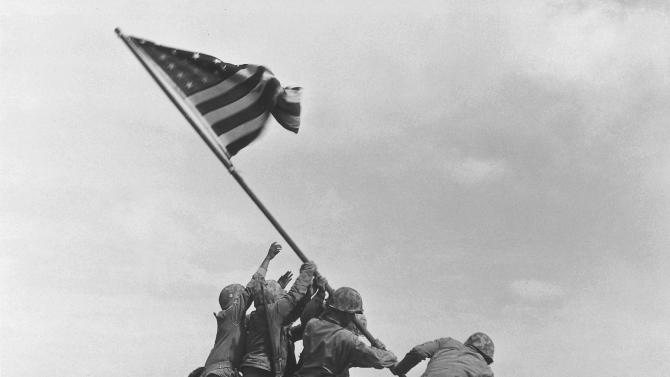 FILE - This Feb. 23, 1945 file photo shows U.S. Marines of the 28th Regiment, 5th Division, raising the American flag atop Mt. Suribachi in Iwo Jima, Japan. Strategically located only 660 miles from Tokyo, the Pacific island became the site of one of the bloodiest, most famous battles of World War II against Japan. The photograph inspired a sculpture by Felix de Weldon which will be auctioned Feb. 22, 2013 in New York. (AP Photo/Joe Rosenthal, File)