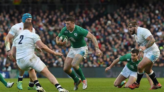 Ireland's centre Robbie Henshaw makes a break during the Six Nations international rugby union match between Ireland and England at Aviva Stadium in Dublin on March 1, 2015
