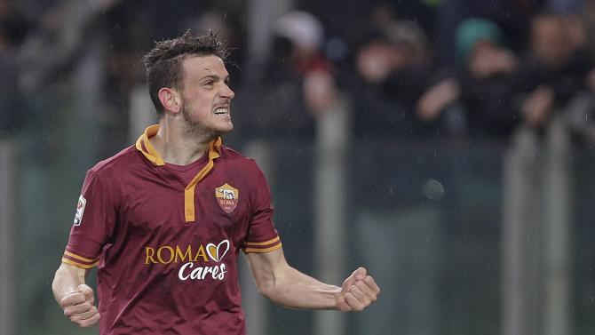 AS Roma's Florenzi celebrates after scoring against Torino during their Italian Serie A soccer match at the Olympic stadium in Rome