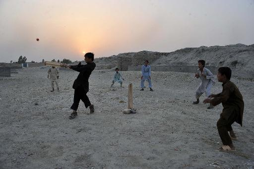 File picture shows Afghan boys playing cricket on the outskirts of Jalalabad in eastern Afghanistan near where local officials said Saturday at least five civilians, including three children, were kil