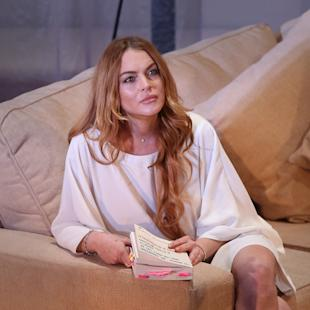 "FILE - In this Tuesday, Sept. 30, 2014 file photo, U.S actress Lindsay Lohan performs a scene from the play, ""Speed the Plow,"" during a photocall at the Playhouse Theatre in central London. A prosecutor said Wednesday, May, 27, 2015, that it appears  Lohan has completed the community service terms of her sentence in a 2012 reckless driving case. A judge will determine on Thursday, May 28, 2015, whether Lohan has completed her sentence, which would release her from probation in Los Angeles for the first time in nearly eight years. (Photo by Joel Ryan/Invision/AP, File)"